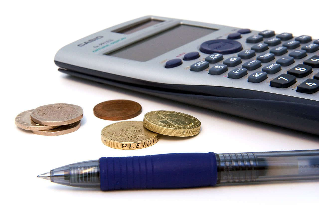 scientifica calculator, coins, and a pen