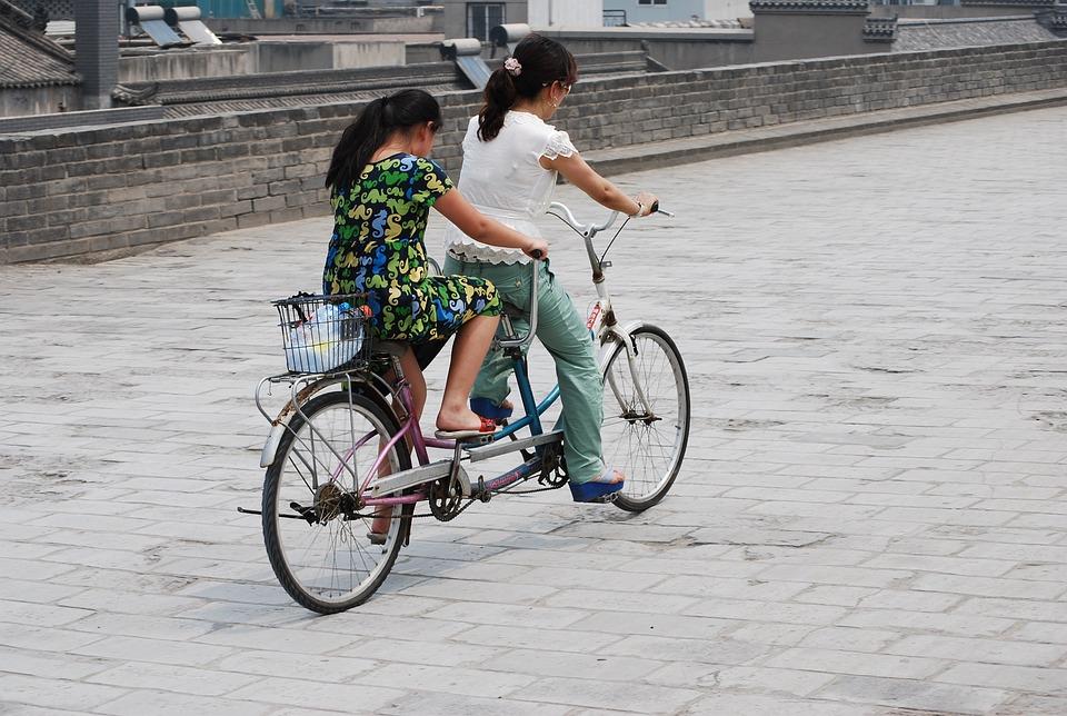 Tandem, Riding