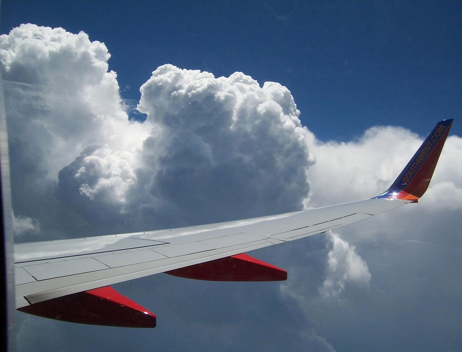 Picture of plane flying in clouds