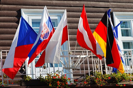 Flags hoisted outside a building