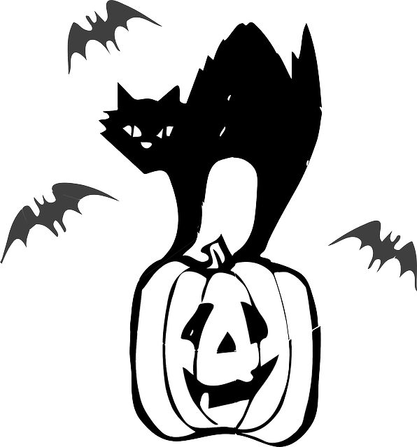 Vector art of a black cat standing on a Jack-O-Lantern