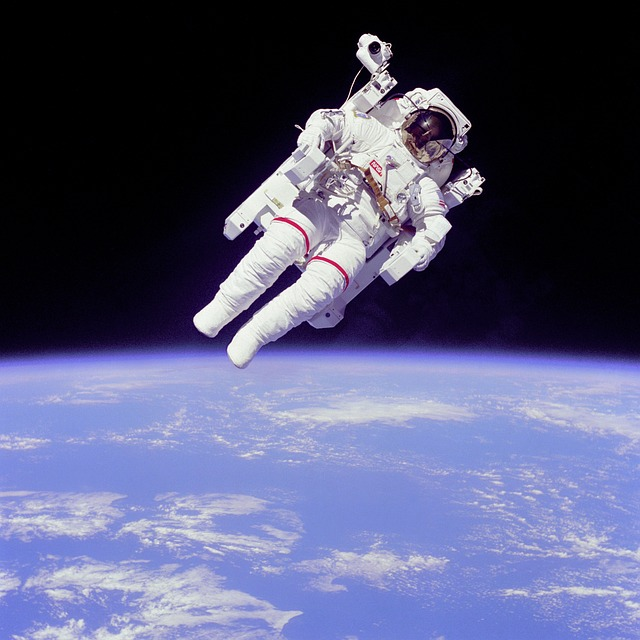 an astronaut floating in space - photo #3