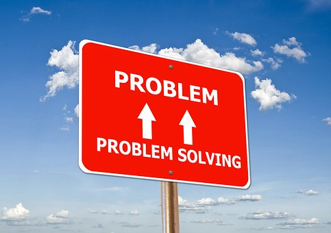 A red signpost with Problem and problem solving on it to signify creating problem solving content for your website
