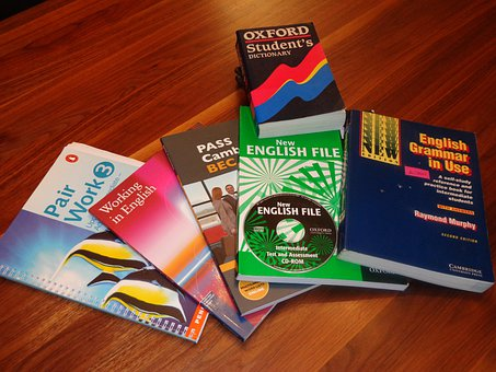 School books on a table to signify educational course