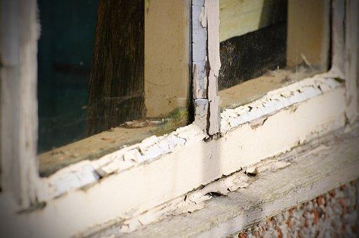Flaking paint around window