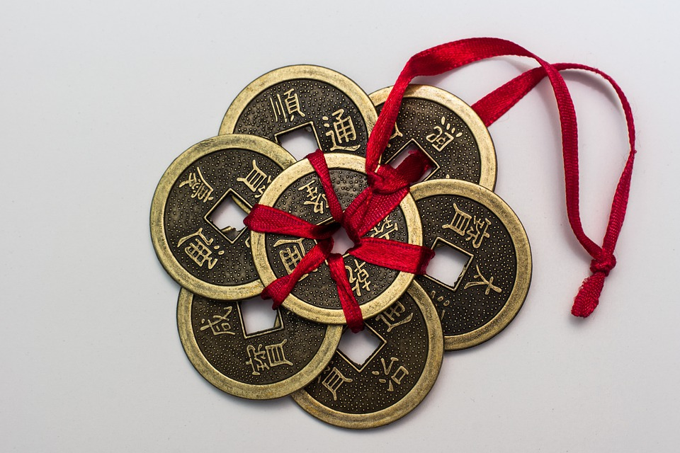Chinese coins in a red tie