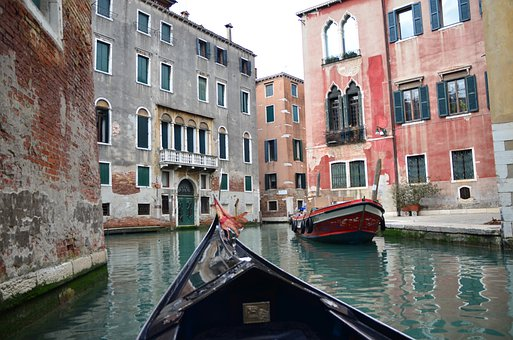 Gondoliers on the waters of Venetia, the floating city in Italy