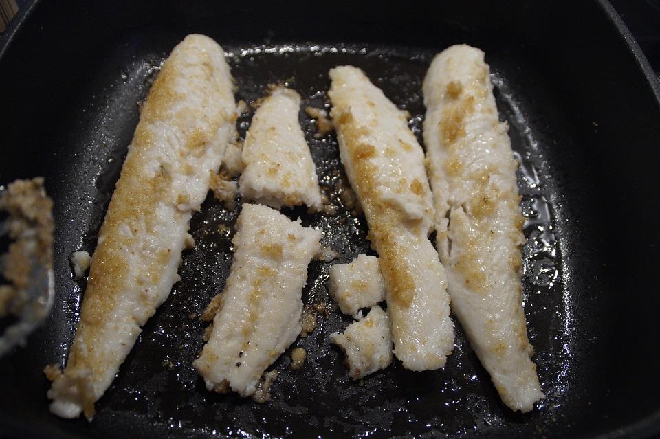 Frying fish using the frying pan