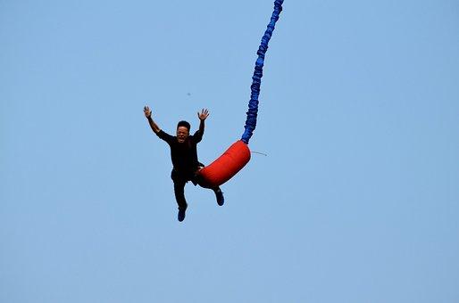 Man going bungee jumping