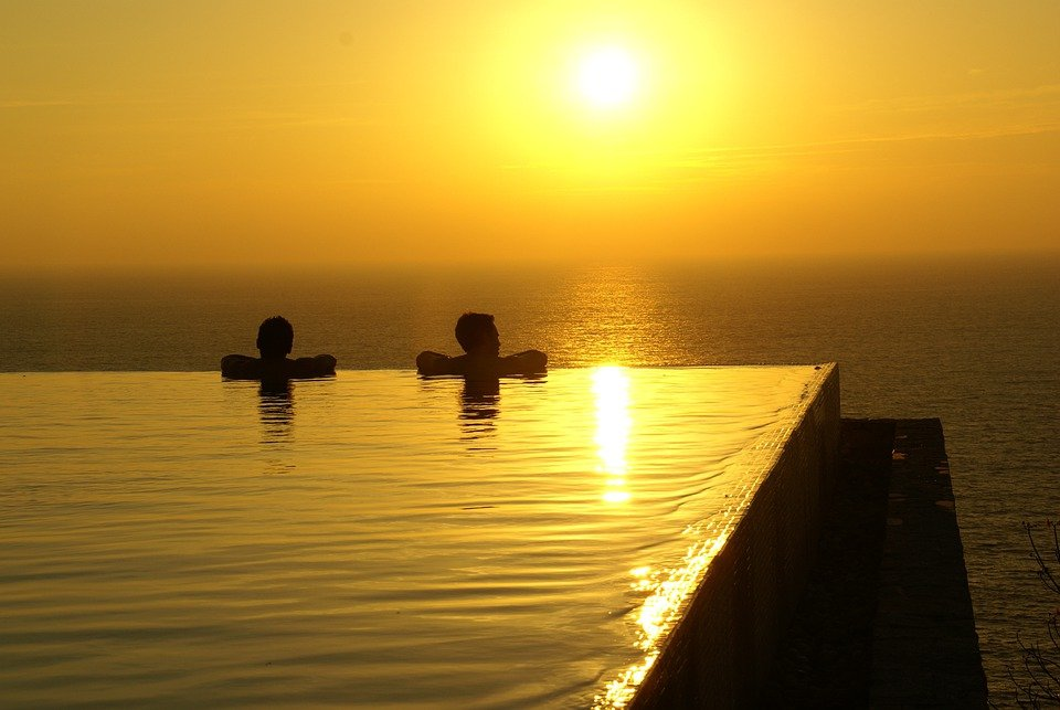 Image result for couple in pool at sunset