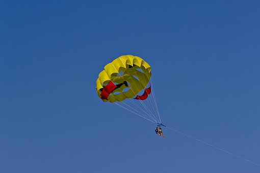 Parasailing in a yellow parachute