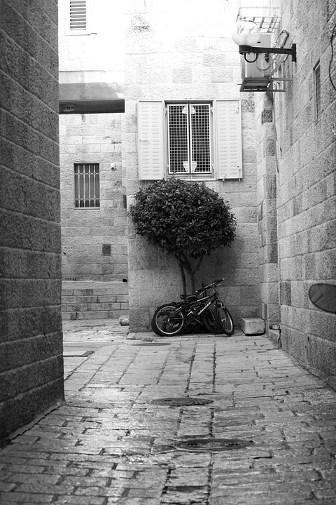 black and white picture of a bicycle in Jerusalem