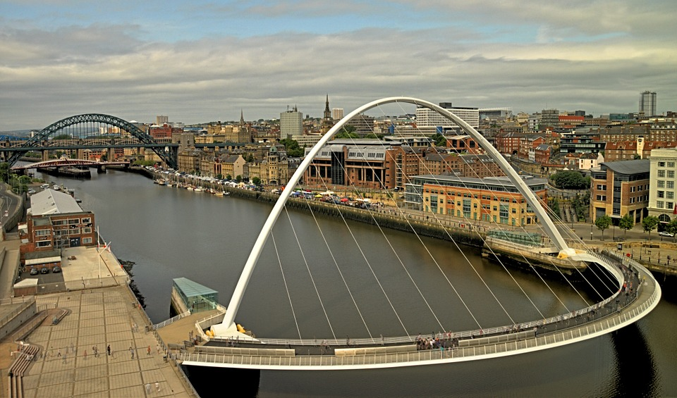 The Tyne bridges, including the Tyne Bridge and the Gateshead Millennium Bridge, with the skyline of Newcastle upon Tyne in the background, as seen from the Baltic Gallery, Gateshead.