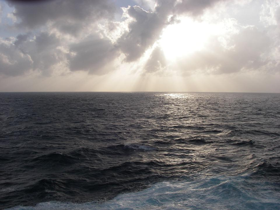 free photo sunset ocean stormy sea clouds free