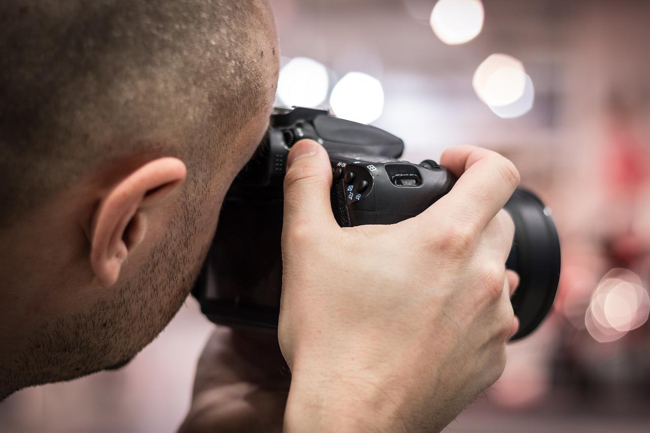 A man using a camera.