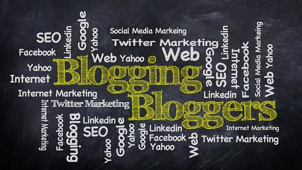 An image with a dark background with large yellow words blogging, bloggers and many others written in white such as SEO, Google, etc.