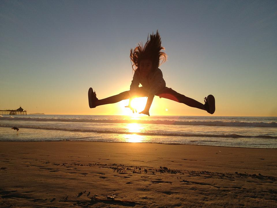 free photo jumping girl jump sunset beach free