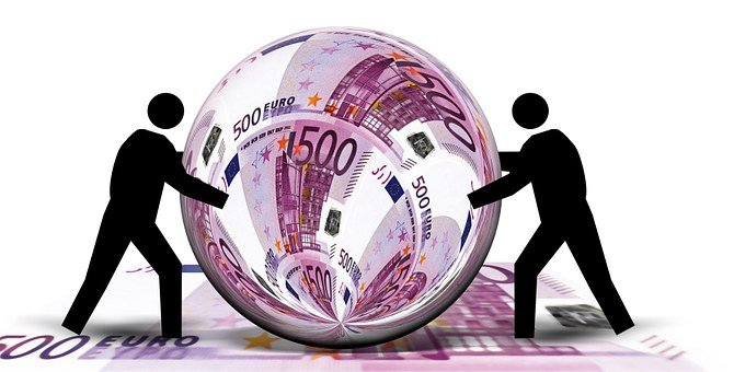 A rolled euro with 2 men in silhouette to mean Online value proposition 2: Find your one best target niche and focus on it