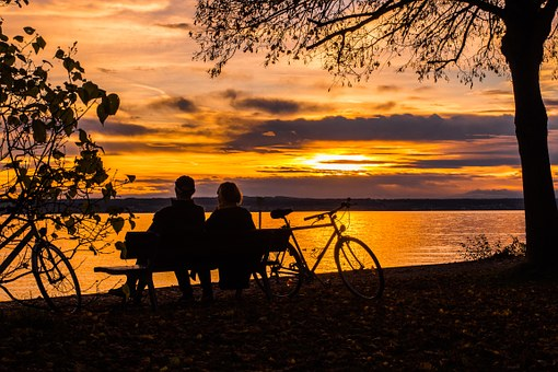 couple enjoying a beautiful sunset, being at peace with the universe and enjoying calm.