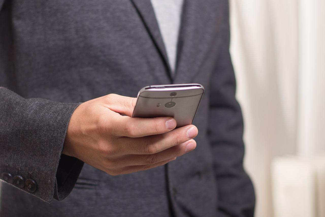 Businessman using his mobile phone.