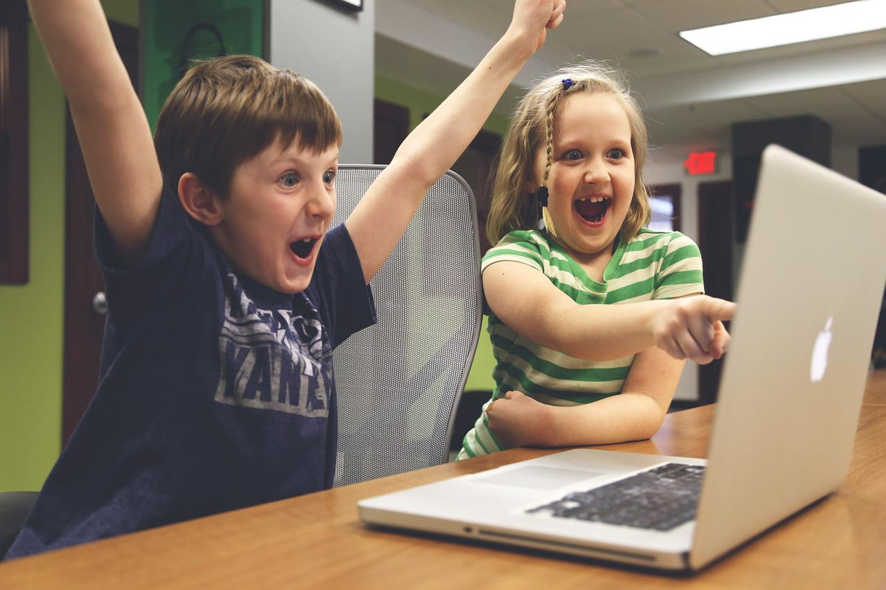 Kids cheering at laptop