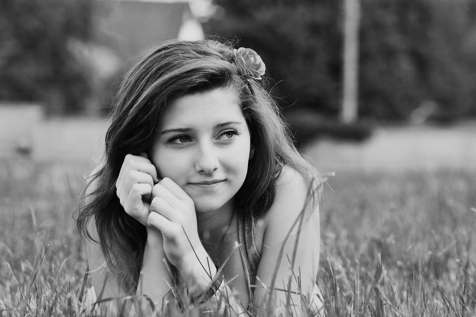 Girl portrait black and white lying relax outdoors