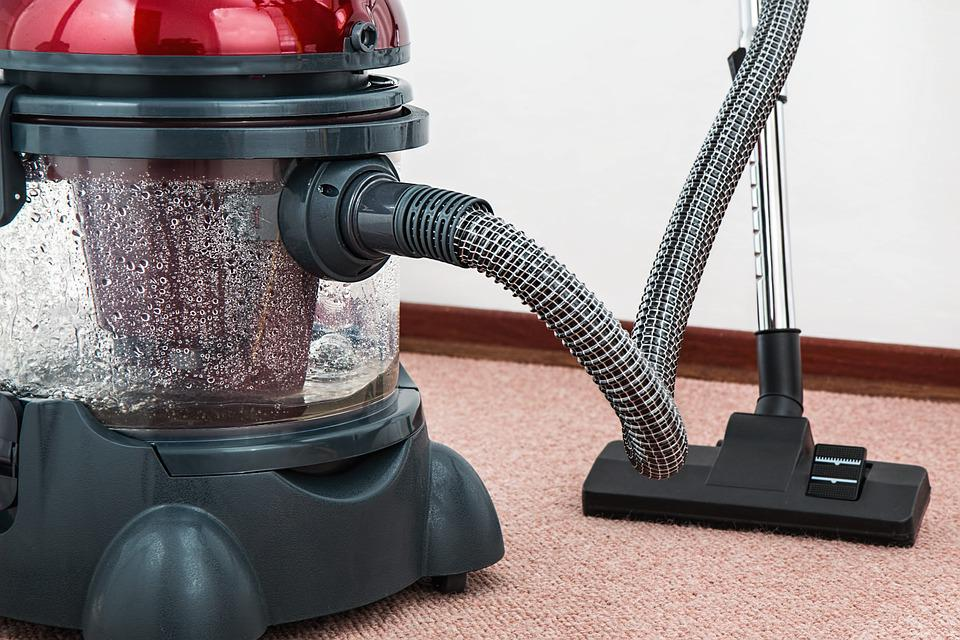 vacuum cleaner in a carpet