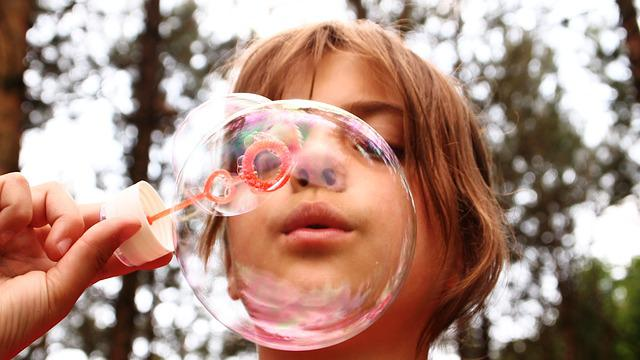 picture of a kid blowing bubbles