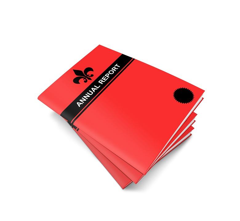 Hvordan lage en brosjyre? Vel, det er mye som skal til, slik som for denne årsrapporten på bildet.