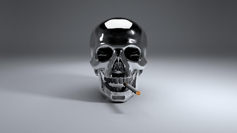 Calavera con un cigarrillo.