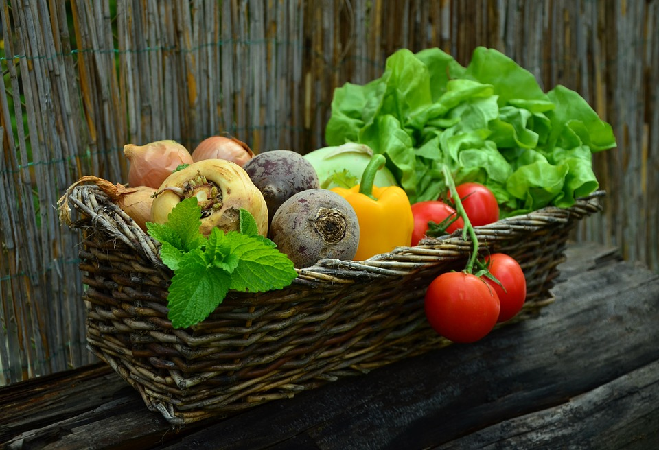 different vegetables in a brown basket