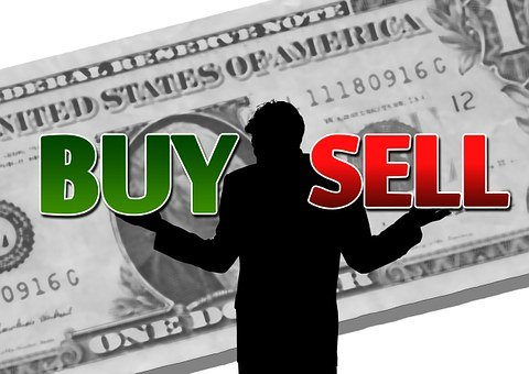 A silhouette in front of an enlarged one dollar bill with BUY in green on his right and SELL in right on the left