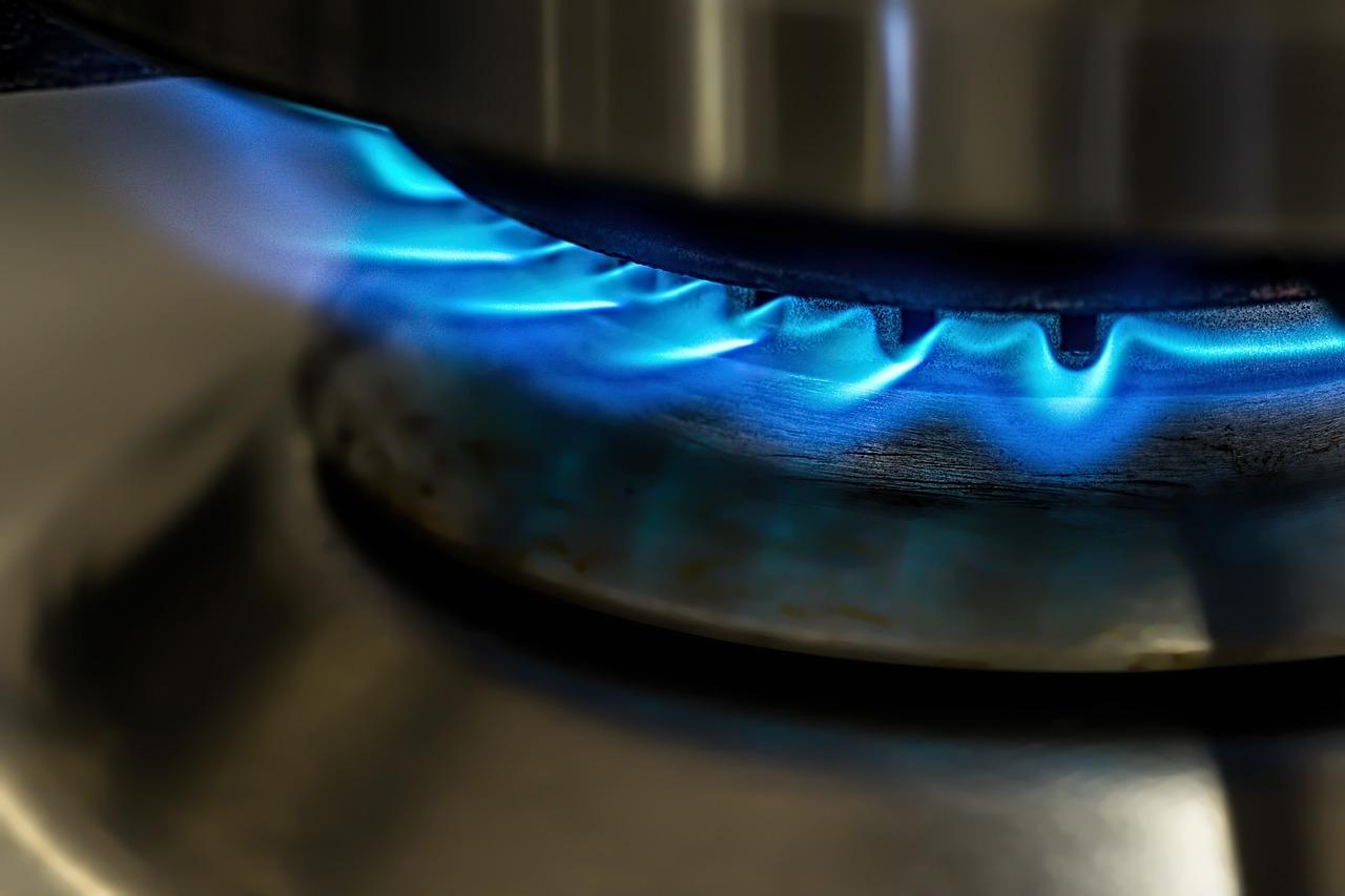 A pot on a gas stovetop.