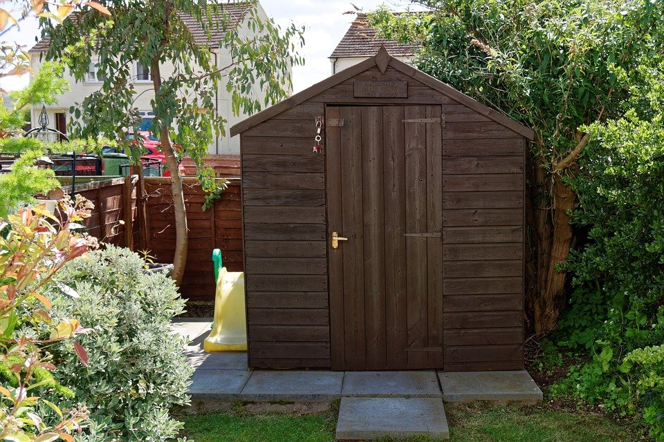 A small shed in a sunny garden