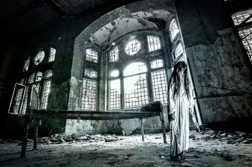 Crazy girl holding a knife in a dilapidated mansion. Black & White with Blue undertones.