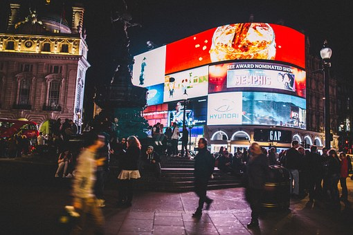 Piccadilly Circus  in London with Neon lights and a crowd