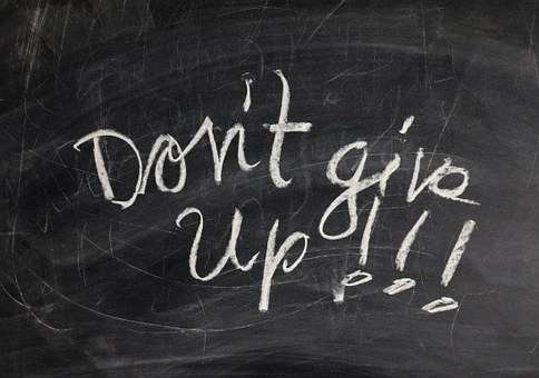 Don't give up!!! written in white on a dark background