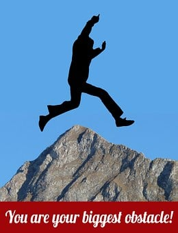 Silhouette jumping over mountain peak
