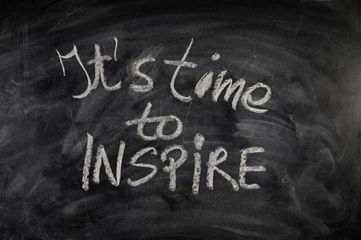 It's time to inspire written on a blackboard as 22 reasons why people read blogs