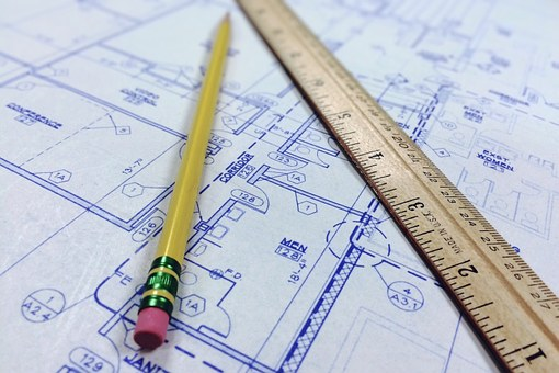 pencil and ruler on a blueprint of life
