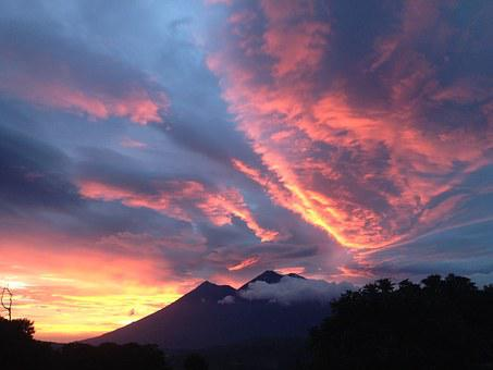 Fiery sky with a volcanic mountain