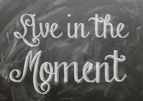 Live in the moment written on a blackboard for 301 inspirational and motivational quotes