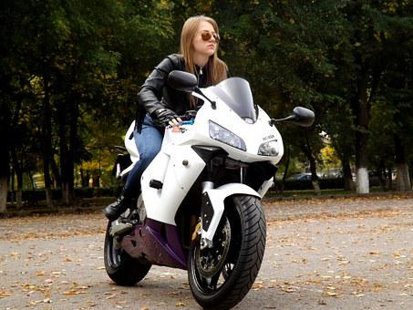 Lady riding on a motorcycle