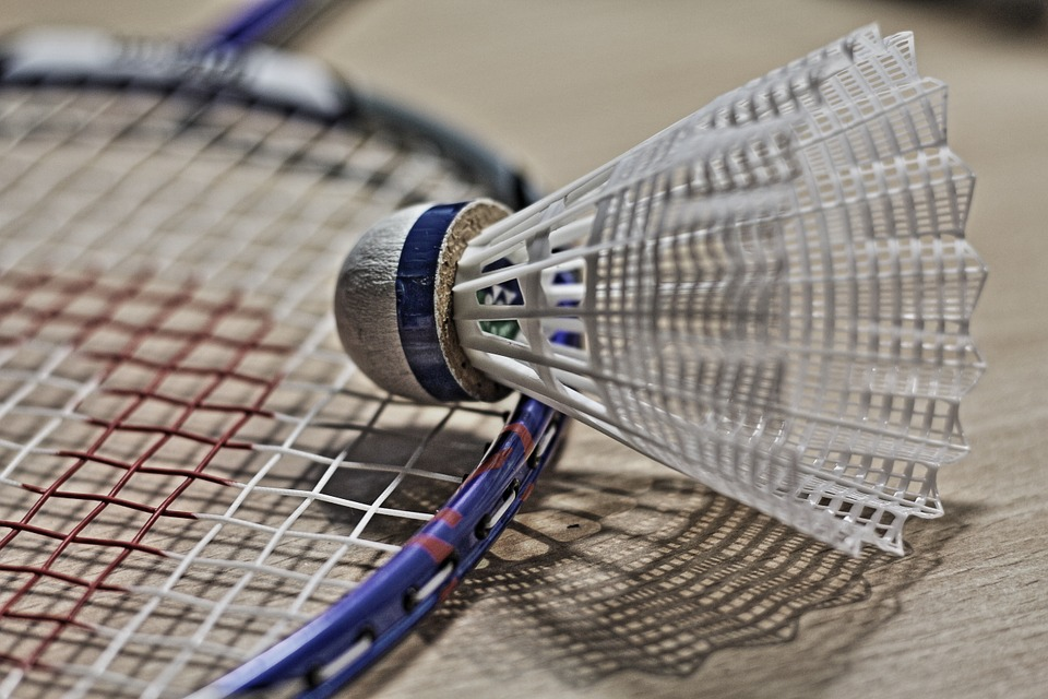 Photo of a badminton near a shuttlecock