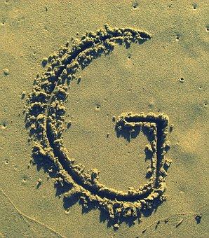 letter g sand stick beach summer