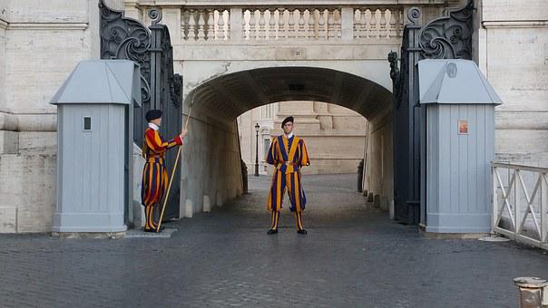 Two Swiss guards standing in front ot the Vatican