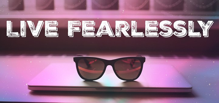 Bright blue and brown image with sunglasses on book and words live fearlessly for 301 inspirational and motivational quotes