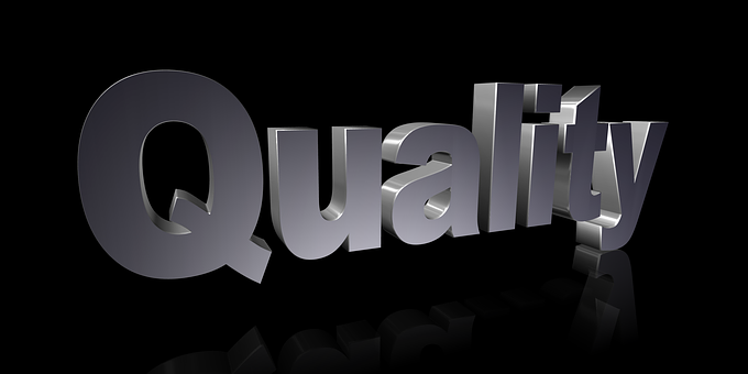 The word Quality standing in light grey color over a dark background
