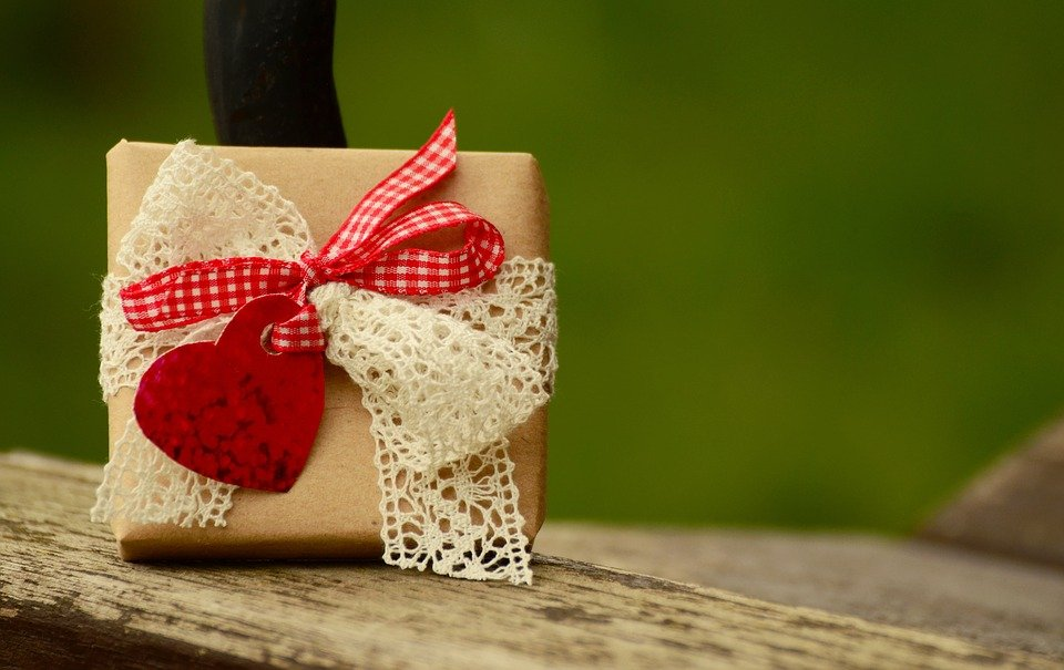 A gift with a red ribbon and heart