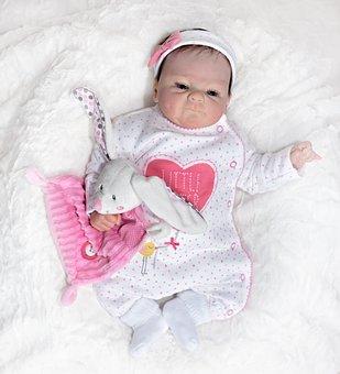 宝宝溢奶和吐奶到底有什么区别?